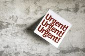 Urgent on Paper Note with texture background