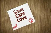 Save Care Love on Paper Note on texture background