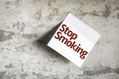 Stop Smoking on Paper Note on sky background