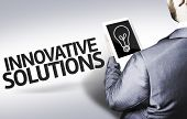 Business man with the text Innovative Solutions in a concept image