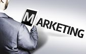 Business man with the text Marketing in a concept image