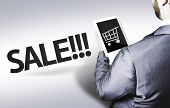 Business man with the text Sale in a concept image