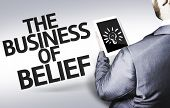 Business man with the text The Business of Belief in a concept image