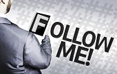 Business man with the text Follow Me in a concept image