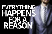 Everything Happens for a Reason written on a board with a business man on background