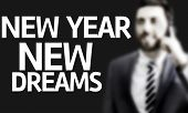 Business man with the text New Year New Dreams in a concept image