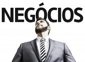 Business man with the text Business (In Portuguese) in a concept image