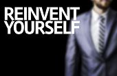 Business man with the text Reinvent Yourself in a concept image