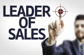 Business man pointing to transparent board with text: Leader of Sales