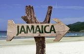 stock photo of rastafari  - Jamaica wooden sign with a beach on background - JPG