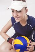 Portrait Of Smiling Caucasian Professional Female Volleyball Player Equipped In Volleyball Outfit An