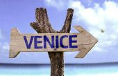 Venice wooden sign with a beach on background
