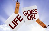 Life Goes On on Paper Note on sky background