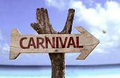 Carnival wooden sign with a beach on background