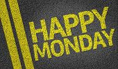 Happy Monday written on the road