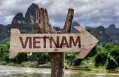 Vietnam wooden sign with agricultural background