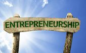 Entrepreneurship wooden sign on a summer day