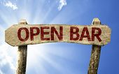 Open Bar wooden sign on a summer day
