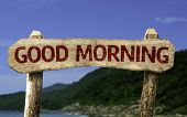 Good Morning sign with a beach on background