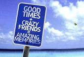 Good Times + Crazy Friends = Amazing Memories sign with a beach on background