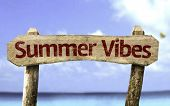 Summer Vibes sign with a beach on background