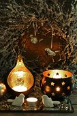 Beautiful candlesticks and other decorations for home interior on dark background