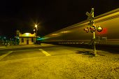 Trains Pass The Railway Crossing By Night