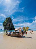 KRABI, Thailand - NOVEMBER  3, 2014: Food and drinks seller on boat at Phranang beach in Krabi, Thailand on NOVEMBER  3, 2014