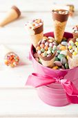 foto of bonbon  - Sweet ice cream and colorful bonbons in the basketselective focus - JPG
