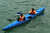Tourist are paddle kayak in Halong Bay,Vietnam.