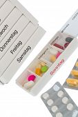 tablet dispenser and tablets, symbolic photo for therapy, prescription, dosage