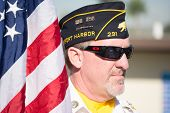 An Unidentified  Veteran With American Flag