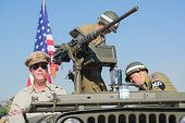 Us Veterans In Military Vehicle