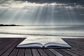 Stunning Sun Rays Bursting From Sky Over Empty Yellow Sand Beach Landscape Conceptual Book Image