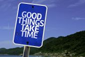 Good Things Take Time sign with a beach on background