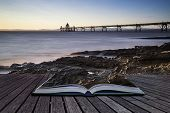 Long Exposure Landscape Image Of Pier At Sunset In Summer Conceptual Book Image