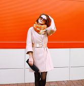 Street Fashion Pretty Stylish Sensual Woman In Coat And Sunglasses With Bag Clutch Posing Outdoors A