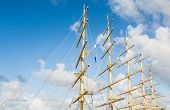 Five Masts Against Sky