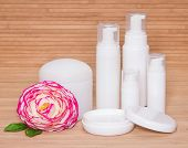 Open Jar Of Cream And Other Body Care Cosmetics With A Flower