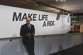 Businessman Inside Bmw Stand At Eicma 2014 In Milan, Italy