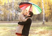 Love, Relationship, Engagement And People Concept - Happy Kissing Couple In Love Outdoors In Autumn