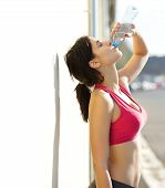 Beautiful Sports Woman Drinking Water From Bottle