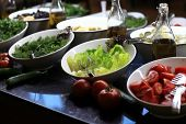 foto of buffet  - Plates with greens and vegetables at a buffet - JPG