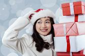 Girl With Santa Hat And Gift Boxes