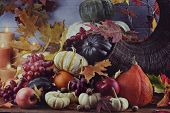 image of horn plenty  - Retro or vintage image of a Cornucopia or Horn of Plenty with lots of fresh vegetables and fruit spilling out - JPG