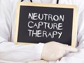 foto of neutrons  - Doctor shows information on blackboard - JPG