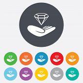 Jewelry insurance sign. Hand holds diamond.