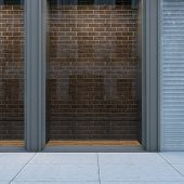 Empty storefront with brickwall