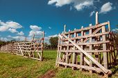 Wooden Rustic Fence, Blue Sky And Village Landscape