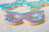 stock photo of shortbread  - Shortbread masquerade mask cookies focus on the centre cookie.